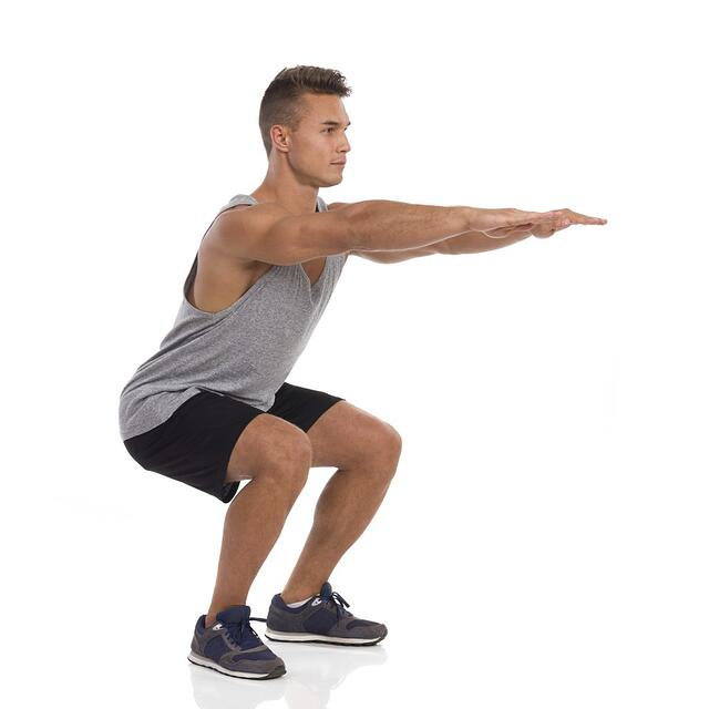 Man doing squat.